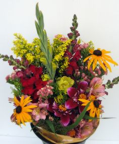 Mid August.  A fresh from the garden bouquet with glad, snaps, and rudebeckia.