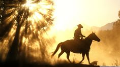 Cowboys and their horses.