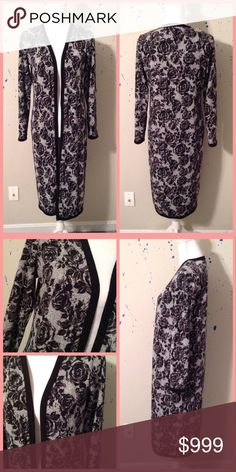 Black Floral Print Duster Size: Medium. Self: 94% Polyester and 6% Spandex. Stretchy! Hot Topic Sweaters