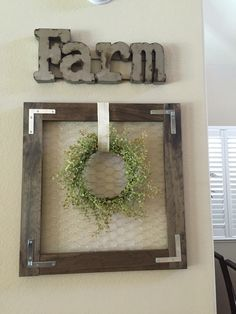 Made this frame with wood, chicken wire and brackets!