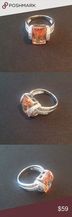 NEW! .925 SS & Champagne Topaz Ring Size 10 NEW! .925 Sterling Silver & Champagne Topaz Ring Size 10! Never Worn, & is in MINT CONDITION!! Jewelry Rings