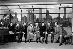 """Alfred Hitchcock talks to the cast of Rope (1948) including Farley Granger, John Dall and James Stewart"""
