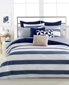 Drift off to sleep surrounded by the Nautica Home Lawndale Navy comforter mini set, featuring an aquatic-inspired white landscape with navy stripes-a relaxed look perfect for any master bedroom or fir