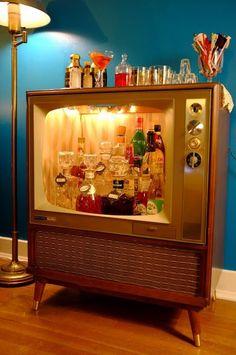 Great use of vintage tv = vintage bar
