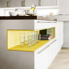 Cutout Island Cutout Island  New to the US, Goldreif's Profile island has a bright-colored interior shelf to display glasses or brag-worthy cookbooks. From $20,000 for cabinets and island; goldreif.com.