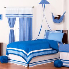 This brilliant blue machine washable bedding set includes everything needed to adorn the bed in style, warmth and comfort. The fluffy comforter features a solid blue with outer stripes while the sheets display a fun dot pattern.