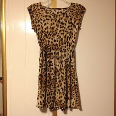Animal Print Dress *NEW WITH NO TAGS* New with no tags Animal PRINT DRESS. The dress says xxl, but it fits like an L, it is very stretchy and it is 31.5 inches long. The dress does have a small stain that is hardly noticeable as seen in the 3rd picture. Dresses Mini
