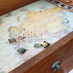 This map-lined DIY shadow box drawer is the perfect way to display travel souvenirs and show where you've been. It's easy and inexpensive!