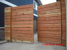 1x6 redwood modern horizontal privacy driveway gates, with electric combo deadbolt #2; (before staining); Marine Ave. Manhattan Beach 90266.jpg