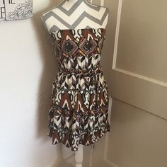 Poema Tiered tribal dress 🎀 Tribal print dress 🎀 Ties at waist purchased at Francescas  🎀 size medium 🎀Please ask for additional pictures, measurements, or ask questions before purchase 🎀No trades or other apps. 🎀Ships next business day, unless otherwise noted in my closet 🎀Reasonable offers accepted  🎀Five star rating 🎀Bundle for discount Poema Dresses