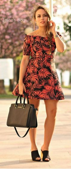 Fabulous palm tree printed short sleeved summer mini dress with black plain leather hand bag and awesome black with golden high heels ladies shoes the best way to show fashion & style