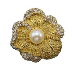 Discover the luxury of Monet with this stunning, yellow floral brooch covered in beads with a massive faux pearl in the center. Clear rhinestones add a lovely trim.