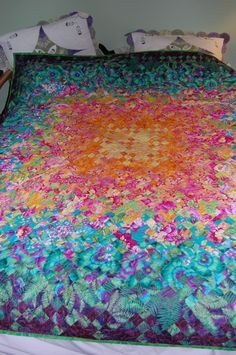 This quilt is called Blooming Nine patch.  Fun to do because it has so many colors in it.