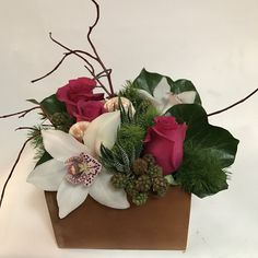 Small Texture Box with roses, cymbidium orchids, blackberries, miniature haworthias and sea shells.