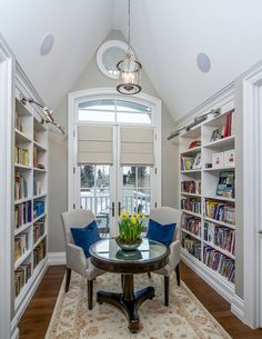 Traditional library and study area by Johnson & Associates Interior Design