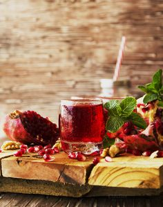 Fresh pomegranates and juice, selective focus by Wild Drago Shop on…