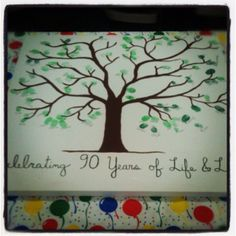 """""""celebrating 90 years of life and love"""" ... I made this for my grandmother's 90th birthday party. Family members and friends made the leaves with their thumbprints."""