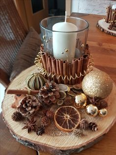 Adventsgesteck mit einer Baumscheibe Advent arrangement with a tree disc Small Christmas Trees, Cheap Christmas, Natural Christmas, Christmas Candles, Rustic Christmas, Simple Christmas, Christmas Crafts, Christmas Ornaments, Elegant Christmas Centerpieces