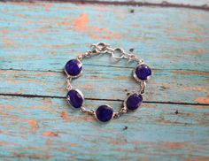 Shop for sapphire on Etsy, the place to express your creativity through the buying and selling of handmade and vintage goods. Sapphire Bracelet, Bracelet Set, Gemstone Jewelry, Etsy Shop, Pendant Necklace, Sterling Silver, Board, Handmade, Stuff To Buy