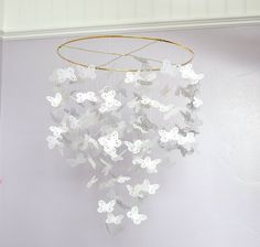Not crazy about the brass ring but: DIY Butterfly Chandelier by themotherhuddle: Lovely for a nursery and easily made with a butterfly punch. tinyurl.com/754aptc  #Butterfly_Mobile #themotherhuddle