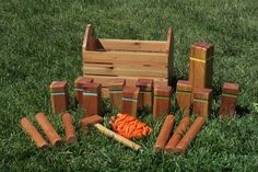 "Kubb (pronounced ""koob"") is a lawn game where the object is to knock over wooden blocks, known as 'kubbs,' by throwing wooden batons at them. This DIY set includes ""regulation-sized"" kubbs, batons, a king, stakes on a pre-measured line for marking the field, and a case with an integrated mallet."