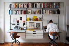 Photo 3 of 14 in How to Create the Best Home Office for Your Living Situation from Two Magazine Creatives Fit Graphic Art and Vintage Furniture in a Brooklyn Apartment - Dwell Home Office Setup, Home Office Space, Office Workspace, Home Office Design, Home Office Furniture, Office Ideas, Bedroom Workspace, Office Shelving, Office Designs
