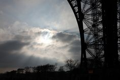 Sun Bursting Through Clouds @ Eiffel Tower