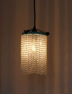 How-To: DIY Beaded Pendant Light-  Love Love Love the simplicity of these.  Look vintage, love these for the downstairs bathroom.