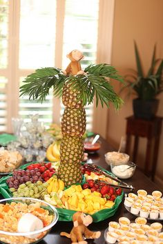 Monkey Birthday Party - Food table with pineapple palm tree in middle Photo by CaraBethStudio.com