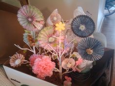 Some of my paper flowers. I made them with the Martha Stewart score board.