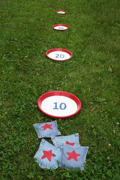 Bean Bag Toss Game, easy DIY ... Get frisbees and mini bean bags and decorate however you'd like