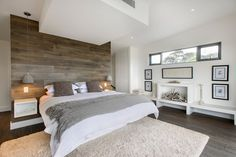 White simple lines, with wood accent wall. Clean, Simple, elegant.