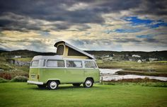 VW camper van bus roof up next to the river