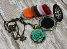 Essential Oil Diffuser Necklace- Aromatherapy Necklace- Antique Bronze Rose Necklace- Rose Diffuser Necklace- Flower Diffuser Necklace- Choose from a Turquoise or Pink Rose!  Would you love to have your favorite essential oils diffusing right under your nose? My essential oil diffuser necklaces allow you to have just that, and have a stylish statement piece at the same time! A simple locket, with a super cute resin rose. Choose either turquoise or pink for your rose, which is firmly…
