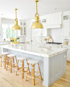 Looking for coastal kitchen ideas? Sharing our white and blue-gray coastal kitchen design! Featuring oversized brass pendants and a coastal kitchen island. Blue Kitchen Designs, Modern Kitchen Design, Interior Design Kitchen, Marble Kitchen Ideas, White Marble Kitchen, White Coastal Kitchen, Coastal Farmhouse, White Shaker Kitchen, Farmhouse Design