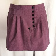 """HAWKS by Geren Ford Railroad Snap Skirt✨HP✨ Edgy mini skirt with railroad thin stripes. The color is pink with dark gray stripes. Tulip style pleating with side pockets. Black coated metal snap placket/closure. 50% cotton; 47% polyester; 3% spandex. Machine washable. Size Small. Waist: 15"""" flat across. Length: 14"""". Light signs of wear in EUC. Urban Outfitters Skirts"""