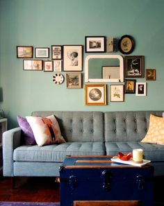 That's a pretty nice art cluster... And the grey sofa and the deep blue + grey + sea foam green all work so nicely together.