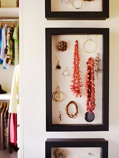 shadow box jewelry storage. plain shadow box with front hinges so contents are easily accessible. jewelry is hung with t pins.