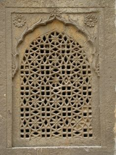 A magnificently carved window overlooking Chand Baori -