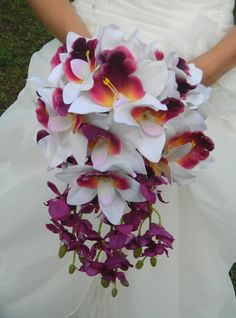 love this one! its the right amount of unique. Orchid wedding bouquet.
