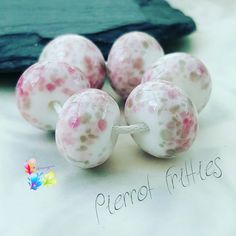Lampwork Beads Perriot Fritties by GlitteringprizeGlass on Etsy Pierrot Fritties! Cute beads with a classic pink and grey theme, using my own exclusive frit blend! #glitteringprizeglass #exclusive #ĺampwork #beads #pink #grey #jewelrydesign #jewellerydesign