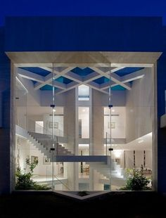 Such beutiful modern interior design with a massive glass wall to show it all off.