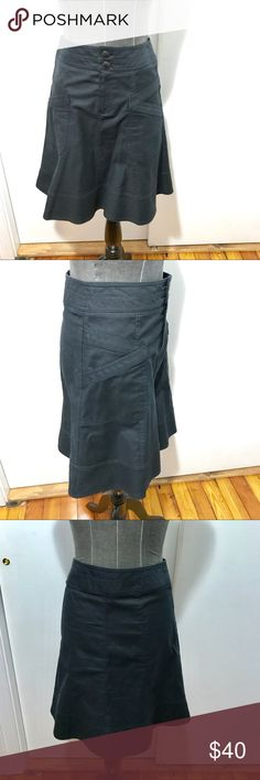 Nanette Lepore A line black knee length skirt 0 2 Nice skirt by Nanette Lepore with fun tailoring details and pockets! It has a front zip and buttons and is in good pre-owned condition. It is marked as a size 0 but has a 28 inches waist so best fits like a 2/4. Nanette Lepore Skirts A-Line or Full