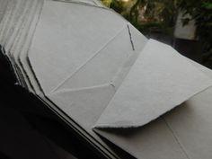 Deckled handmade paper envelope in taupe color