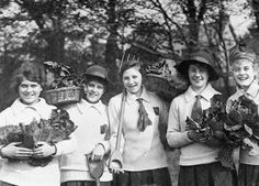 Schoolgirls doing their bit to stave off the German threat by growing vegetables in their school grounds, spring 1918.