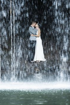 gorgeous post wedding photograph under a waterfall in maui photography by trishbarkerphotography