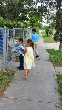 Our kids eager for their turn to preach and leave a JW.org tract.