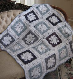 Woolly's Snowflake square, free pattern by Letitia Sherriff ; joined here with granny cluster rounds by sharonhk (pic from Ravelry Project Gallery) . . . .