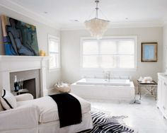 I love the idea of a fireplace and a chaise in a master bathroom.
