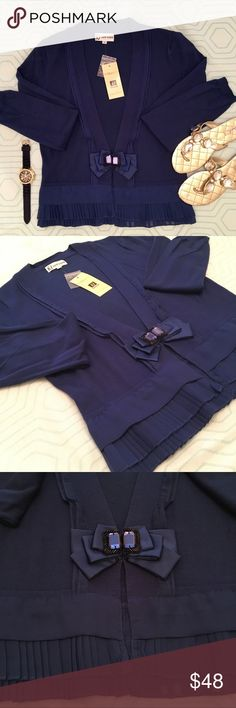 🆕 Navy cardigan with pleated ruffles Nancy Yang New York navy long sleeved cardigan with pleated ruffled trim and embellished bow. Two hook and eye clasps at the bow. This is a lovely cardigan that can be worn over any type of shirt, dress or bottom. NWT excellent condition. ✨price is as listed. No offers please✨ Nancy Yang New York Sweaters Cardigans